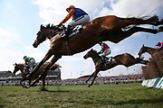 Winner Ornua and Davy Russell (6) leads Knocknanuss ridden by Jamie Moore  and Us and Them ridden by JJ Slevin in the  3.00pm The Doom Bar Maghull Novices' Steeple Chase (Grade 1) 2m during the Grand National Meeting at Aintree, Liverpool, United Kingdom on 6 April 2019.