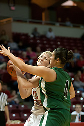 13 November 2005: Ashley Sandstead growls at Katie O'Grady as she heads for the bucket.  With a final score was 93-58, the Illinois State University Redbirds overcome the Bearcats of Northwest Missouri State in an exhibition match up Sunday afternoon at Redbird Arena in Normal Illinois.  The final score was 93-58.