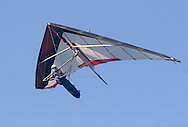 Ellenville, NY - A man flying a hang glider soars above Ellenvilleon May 30, 2009.