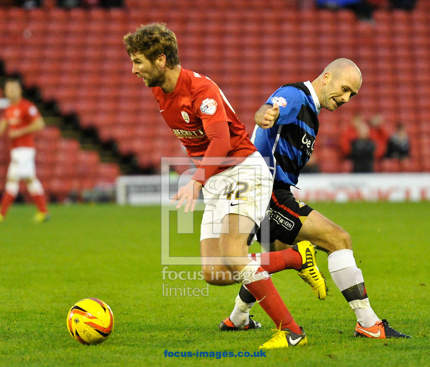 Picture by Richard Land/Focus Images Ltd +44 7713 507003<br /> 09/11/2013<br /> Paddy McCourt of Barnsley goes past Paul Keegan of Doncaster Rovers during the Sky Bet Championship match at Oakwell, Barnsley.