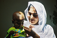 Pakistan, Karachi, 2004. Volunteers keep records of each new arrival's health and history. Every year, the Edhi Foundation gives a second chance to hundreds of children.