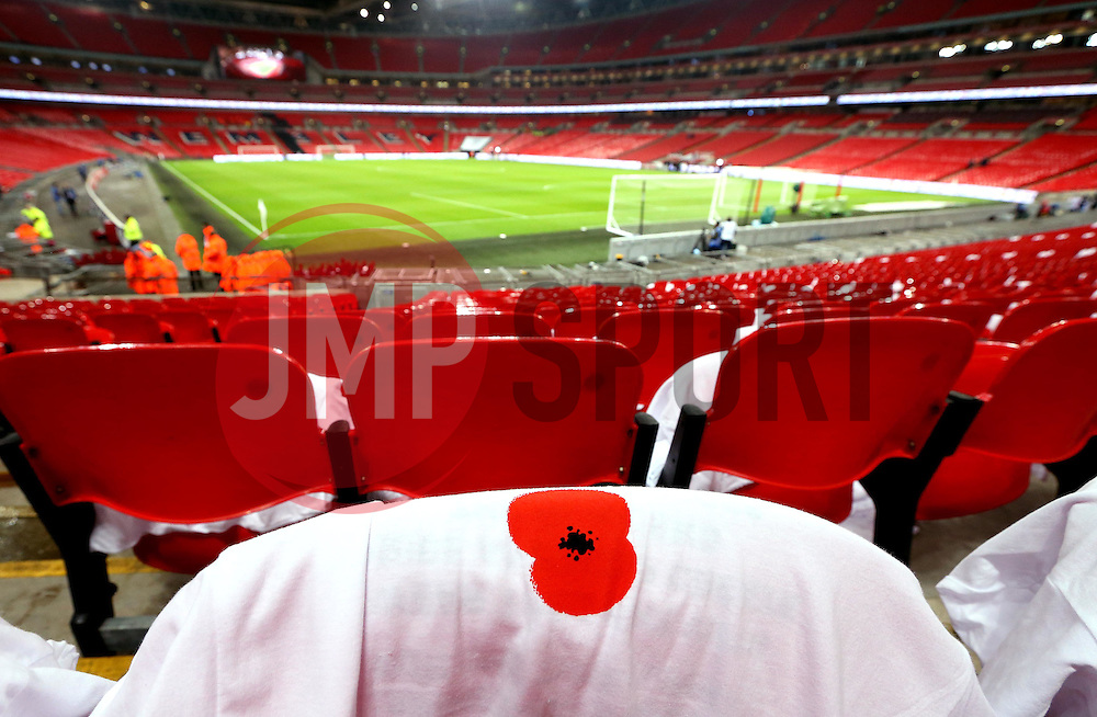 Shirts with poppies printed on are laid on seats for fans at Wembley Stadium ahead of The UEFA European World Cup Qualifier between England and Scotland - Mandatory by-line: Robbie Stephenson/JMP - 11/11/2016 - FOOTBALL - Wembley Stadium - London, United Kingdom - England v Scotland - European World Cup Qualifiers