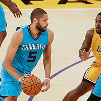 28 February 2017: Charlotte Hornets guard Nicolas Batum (5) drives past Los Angeles Lakers center Tarik Black (28) on a screen set by Charlotte Hornets center Frank Kaminsky III (44) during the Charlotte Hornets 109-104 victory over the LA Lakers, at the Staples Center, Los Angeles, California, USA.