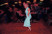 A Conservative Party delegate dances on her own during a party at the 1992 Conservative Party Conference, on 18th March 1992, in Brighton, England. Prime Minister of the day, John Major went on to win the election weeks later and was the fourth consecutive victory for the Tory Party although it was its last outright win until 2015 after Labour's 1997 win for Tony Blair.