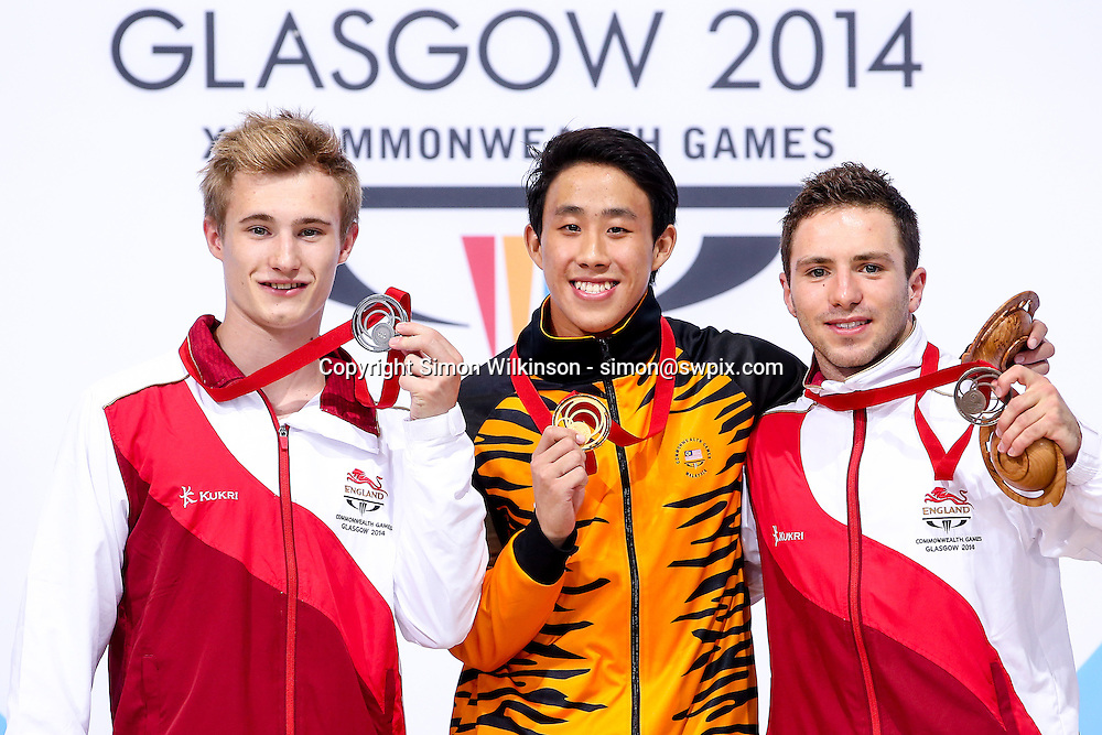 Picture by Alex Whitehead/SWpix.com - 31/07/2014 - 2014 Glasgow Commonwealth Games, Day 8 - Diving - Royal Commonwealth Pool, Edinburgh, Scotland - Men's 3m Springboard final, Gold - Ooi Tze Liang (Malaysia), Silver - Jack Laugher (England), Bronze - Oliver Dingley (England).