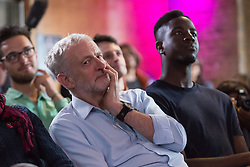 © Licensed to London News Pictures. 01/09/2015. London, UK. Jeremy Corbyn listening to speeches sitting next to singer, Jermain Jackman at the Arcola Theatre in Dalston, east London this evening, where he launched his Vision for the future of the arts. Photo credit : Vickie Flores/LNP