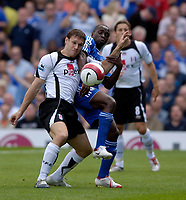 Photo: Daniel Hambury.<br />Fulham v Chelsea. The Barclays Premiership. 23/09/2006.<br />Fulham's Moritz Volz and Chelsea's Claude Makelele battle.