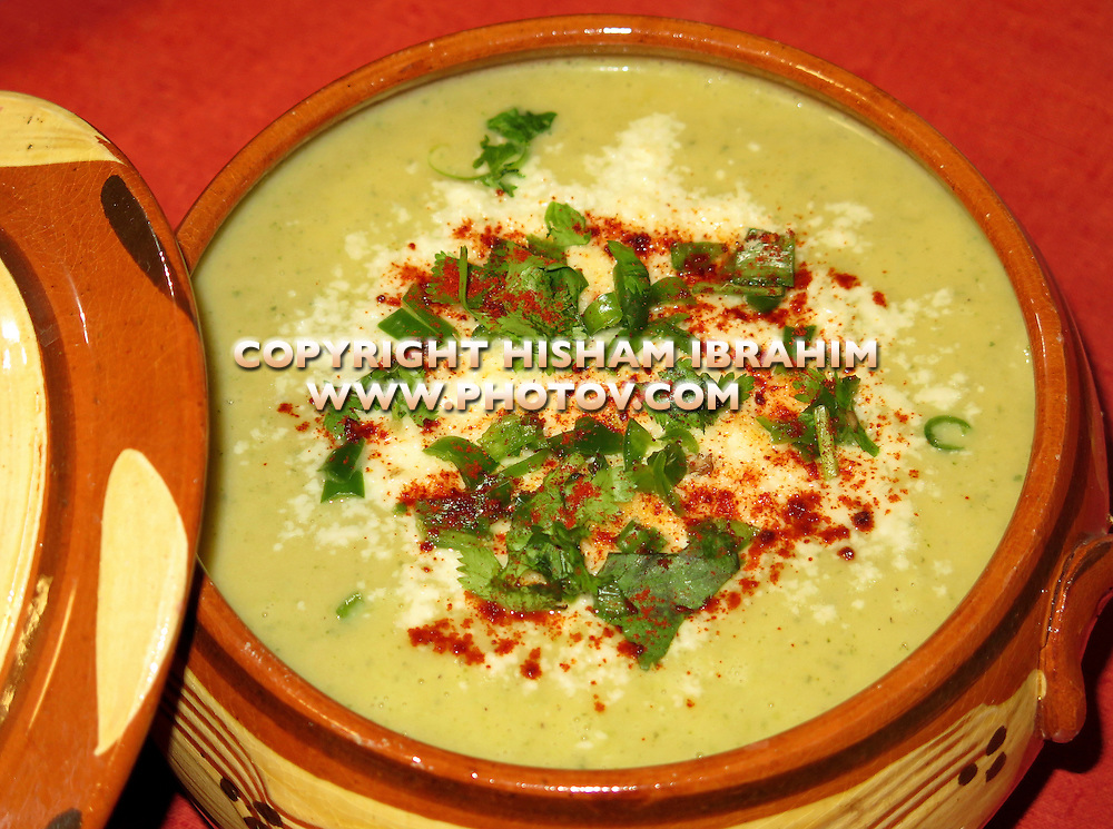 Zucchini and Sweet Potato Soup topped with paprika, cilantro and Parmesan Cheese - Middle Eastern Food