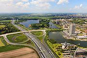 Nederland, Noord-Brabant, Den Bosch, 27-05-2013; Afslag en A2 met zicht op  Plan Zuid / De Pettelaar. Provinciehuis en Zuiderplas. In het water de gerestaureerde Pettelaarse Schans.<br /> Stadsuitbreiding en nieuwbouwwijk uit de jaren vijftig en zestig van de vorige eeuw, wederopbouwperiode. Groen en ruim opgezet.<br /> New residential area built in the fifties and sixties in Den Bosch. Spacious and plentyful green areas. Motorway A2.<br /> Reconstruction area.<br /> luchtfoto (toeslag op standard tarieven)<br /> aerial photo (additional fee required)<br /> copyright foto/photo Siebe Swart