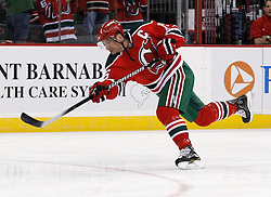 "Mar 17, 2010; Newark, NJ, USA; New Jersey Devils right wing Jamie Langenbrunner (15) takes a shot during the warmups at the Prudential Center. The Devils are wearing their ""retro"" jerseys for their game against the Pittsburgh Penguins tonight."
