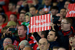 """CARDIFF, WALES - Monday, October 9, 2017: Wales supporters sing the national anthem as the hold up placards """"we are The Red Wall"""" before the 2018 FIFA World Cup Qualifying Group D match between Wales and Republic of Ireland at the Cardiff City Stadium. (Pic by Paul Greenwood/Propaganda)"""