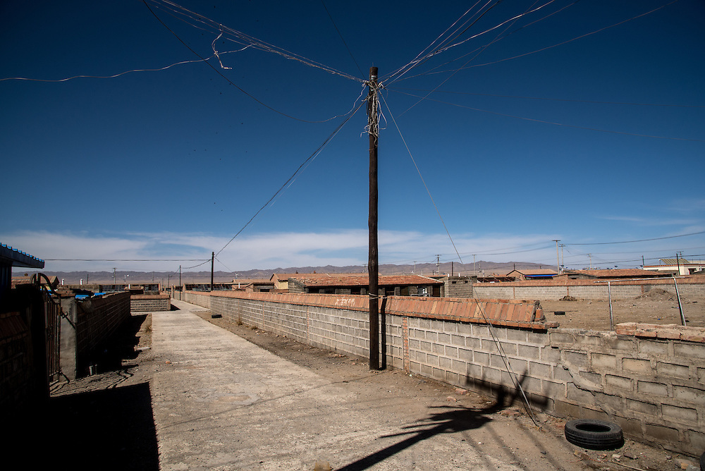 The empty streets of a small town built by the government to accomodate nomadic Tibetans. Such communities are part of an effort by the Chinese government to keep nomadic Tibetans stationary and contained. Golok region, Tibet.