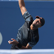 Jo-Wilfred Tsonga, France, is attacked by a flying insect as he serves against Andy Murray, Great Britain, during the US Open Tennis Tournament, Flushing, New York, USA. 1st September 2014. Photo Tim Clayton