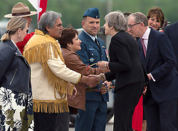 British Prime Minister Theresa May and her husband Philip May, right, are welcomed as they arrive at CFB Bagotville, Quebec, Canada for the annual summit of G7 leaders on Thursday, June 7, 2018. The event will be held in La Malbaie, in the Charlevoix region of Quebec. Photo by Andrew Vaughan/CP/ABACAPRESS.COM