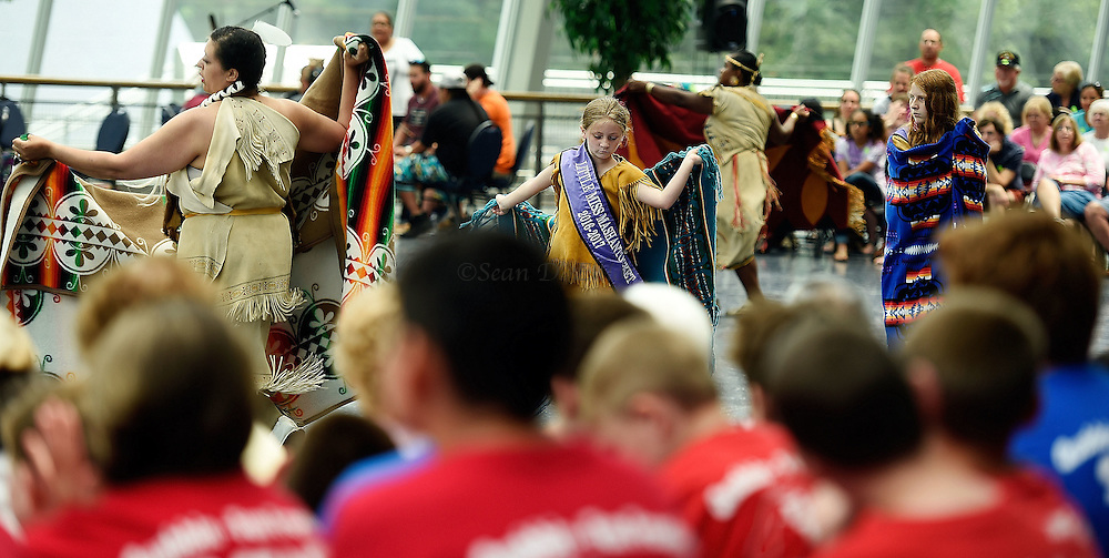 7/7/16 :: REGION :: STAND ALONE :: Dancers demonstrate the Eastern Blanket dance during the annual Educational Powwow at the Mashantucket Pequot Museum and Research Center Thursday, July 7, 2016. The Educational Powwow is a narrated exhibition showcasing Native American dancers and the significance of this cultural gathering for indigenous people. The event was free with museum admission. Eastern woodland cuisine was offered in the restaurant and native artists were set up demonstrating and selling their crafts. (Sean D. Elliot/The Day)