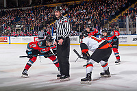 KELOWNA, CANADA - NOVEMBER 25: Linesman Tim Plamondon stands at the face off with Dillon Dube #19 of the Kelowna Rockets against the Medicine Hat Tigers on November 25, 2017 at Prospera Place in Kelowna, British Columbia, Canada.  (Photo by Marissa Baecker/Shoot the Breeze)  *** Local Caption ***