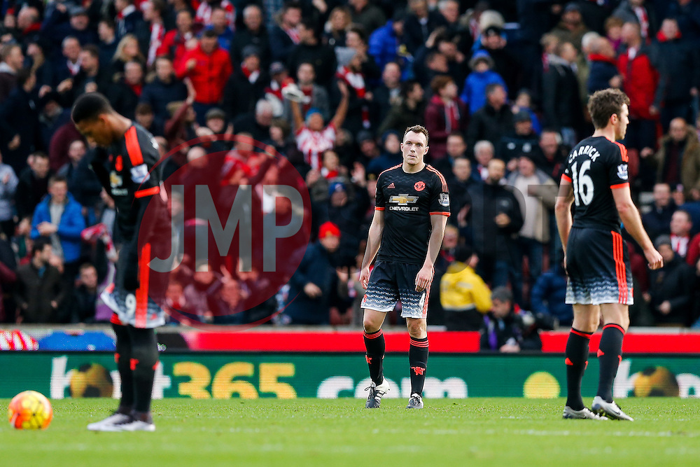 Phil Jones of Manchester United looks dejected after Stoke City score the opening goal - Mandatory byline: Rogan Thomson/JMP - 26/12/2015 - FOOTBALL - Britannia Stadium - Stoke, England - Stoke City v Manchester United - Barclays Premier League - Boxing Day Fixture.