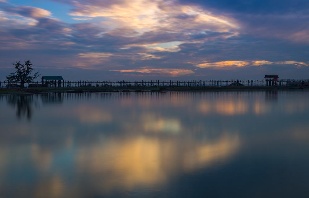 Sunset in the U Bein Bridge in Amarpura in the Mandalay Region in Myanmar
