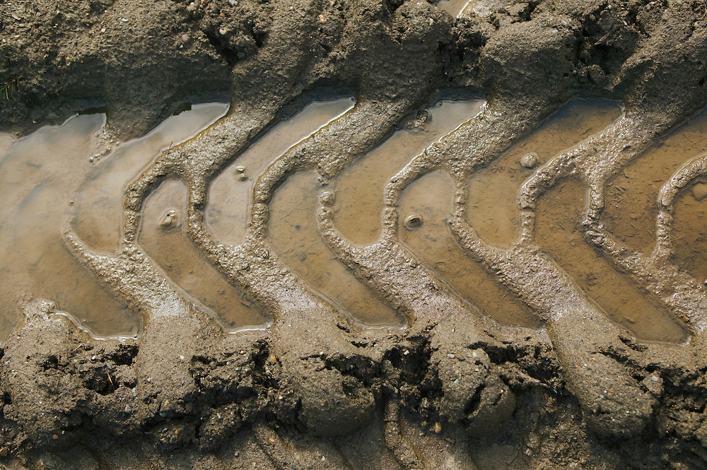 Closeup of tire track in wet muddy soil