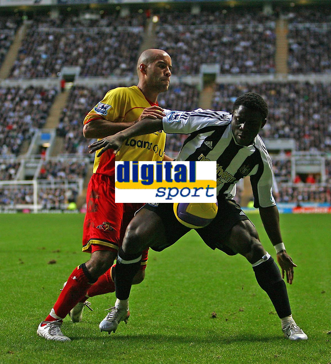 Photo: Andrew Unwin.<br />Newcastle United v Watford. The Barclays Premiership. 16/12/2006.<br />Newcastle's Obafemi Martins (R) holds off Watford's James Chambers (L).