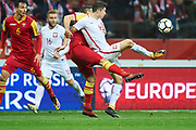 Warsaw, Poland - 2017 October 08: Robert Lewandowski of Poland fights for the ball during soccer match Poland v Montenegro - FIFA 2018 World Cup Qualifier at PGE National Stadium on October 08, 2017 in Warsaw, Poland.<br /> <br /> Mandatory credit:<br /> Photo by &copy; Adam Nurkiewicz / Mediasport<br /> <br /> Adam Nurkiewicz declares that he has no rights to the image of people at the photographs of his authorship.<br /> <br /> Picture also available in RAW (NEF) or TIFF format on special request.<br /> <br /> Any editorial, commercial or promotional use requires written permission from the author of image.