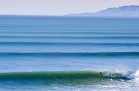 A surfer riding waves during a big winter swell at Surfers Point in Ventura, California on January 20, 2013.
