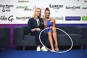 Aleksandra Soldatova with her coach Anna Dyachenko on Kiss and Cry at World Cup Pesaro 2018.<br />