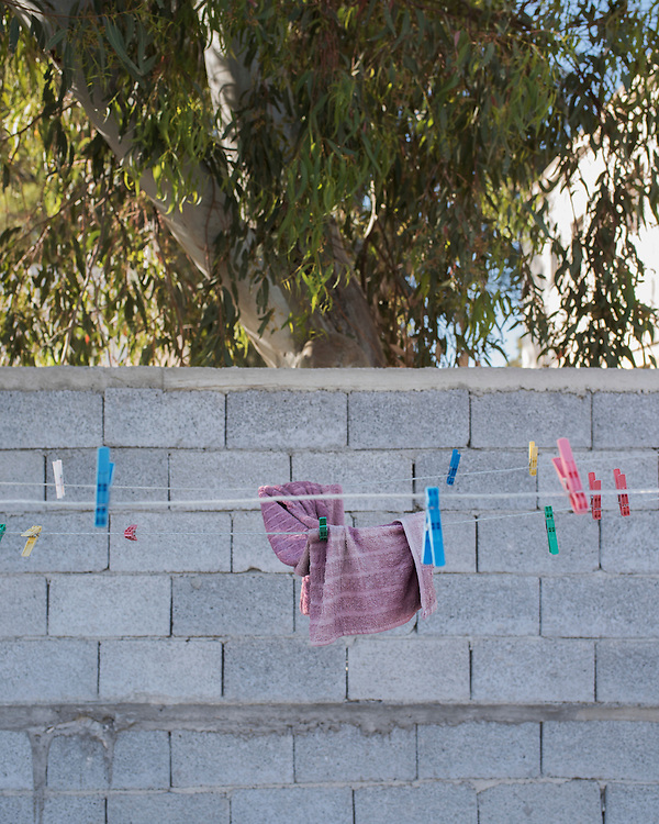 A towel, left forgotten, on a clothes line at the former refugee camp in the port of Lakki.<br />