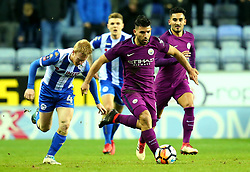 Sergio Aguero of Manchester City goes past David Perkins of Wigan Athletic - Mandatory by-line: Robbie Stephenson/JMP - 19/02/2018 - FOOTBALL - DW Stadium - Wigan, England - Wigan Athletic v Manchester City - Emirates FA Cup fifth round proper