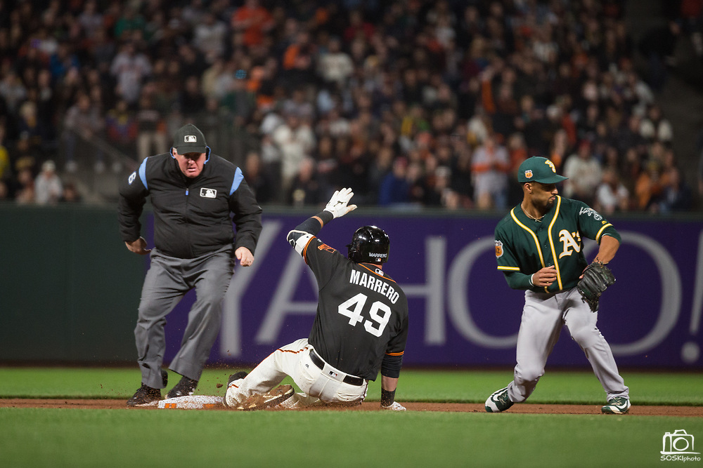 San Francisco Giants first baseman Chris Marrero (49) slides into second base after a double against the Oakland Athletics at AT&T Park in San Francisco, California, on March 30, 2017. (Stan Olszewski/Special to S.F. Examiner)