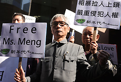December 18, 2018 - Hong Kong, China - An old man dressed in formal Chinese national costume protesting at downstair Canadian Consulate General together with his pro-China demonstrators calling for immediate releasing of Meng Wanzhou. (Credit Image: © Liau Chung-ren/ZUMA Wire)