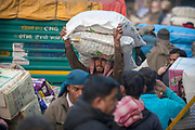 A worker balancing a sack on his head in Chandni Chowk, Old Delhi, India.
