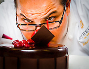 Pastry Chef Antonio Bachour makes a chocolate and rasberry entremet, a kind of cake, at the St. Regis Bal Harbour Resort