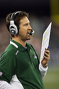 New York Jets Offensive Coordinator Brian Schottenheimer calls out a play while looking at his play chart during the NFL football game against the Buffalo Bills, December 3, 2009 in Toronto, Canada. The Jets won the game 19-13. ©Paul Anthony Spinelli