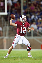 September 26, 2009; Stanford, CA, USA; Stanford Cardinal quarterback Andrew Luck (12) passes the ball against the Washington Huskies during the first quarter at Stanford Stadium. Stanford defeated Washington 34-14. Mandatory Credit: Jason O. Watson-US PRESSWIRE