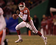 University of Oklahoma quarterback Paul Thompson rolls out against Nebraska during the Big 12 Championship game at Arrowhead Stadium in Kansas City, Missouri, December 2, 2006.  Oklahoma beat Nebraska 21-7.<br />