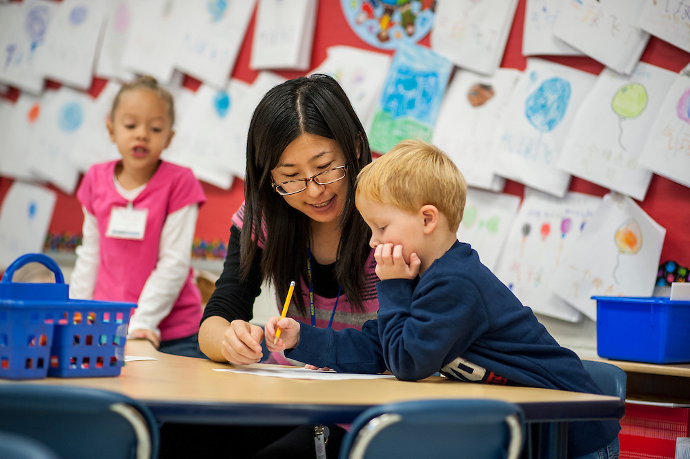 Kindergarten teacher An Wei works on addition with C.J. Hunt at J. Ralph McIlvaine Early Childhood Center in Magnolia, Delaware, on Wednesday, November 14, 2012. Ms. An is one of two Chinese language immersion program teachers at the school. Students split normal kindergarten curriculum in Chinese for half a day and in English for the remainder..Matt Roth for Education Week ..