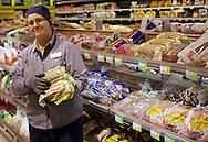 In Finland most organic products are sold in supermarkets. Mervi Saarela at S-Market Bulevardi presenting Samsara organic rye sour bread.