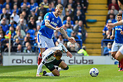 Portsmouth Midfielder, Carl Baker (7) tackles by Plymouth Argyle Defender, Gary Sawyer (3) during the EFL Sky Bet League 2 match between Portsmouth and Plymouth Argyle at Fratton Park, Portsmouth, England on 14 April 2017. Photo by Adam Rivers.
