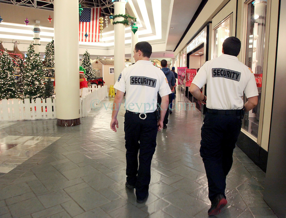 23 November 2012. New Orleans, Louisiana.<br /> Black Friday.  Security guards patrol the crowds as Shoppers descend on discountedprices at the Lakeside Mall on the traditional post Thanksgiving shopping frenzy.<br /> Photo; Charlie Varley/varleypix.com