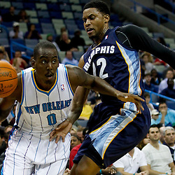 December 21, 2011; New Orleans, LA, USA; New Orleans Hornets small forward Al-Farouq Aminu (0) drives past Memphis Grizzlies small forward Rudy Gay (22) during the first quarter of a game at the New Orleans Arena.   Mandatory Credit: Derick E. Hingle-US PRESSWIRE