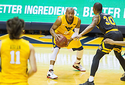 Dec 23, 2016; Morgantown, WV, USA; West Virginia Mountaineers guard Jevon Carter (2) passes to West Virginia Mountaineers forward Nathan Adrian (11) during the first half against the Northern Kentucky Norse at WVU Coliseum. Mandatory Credit: Ben Queen-USA TODAY Sports