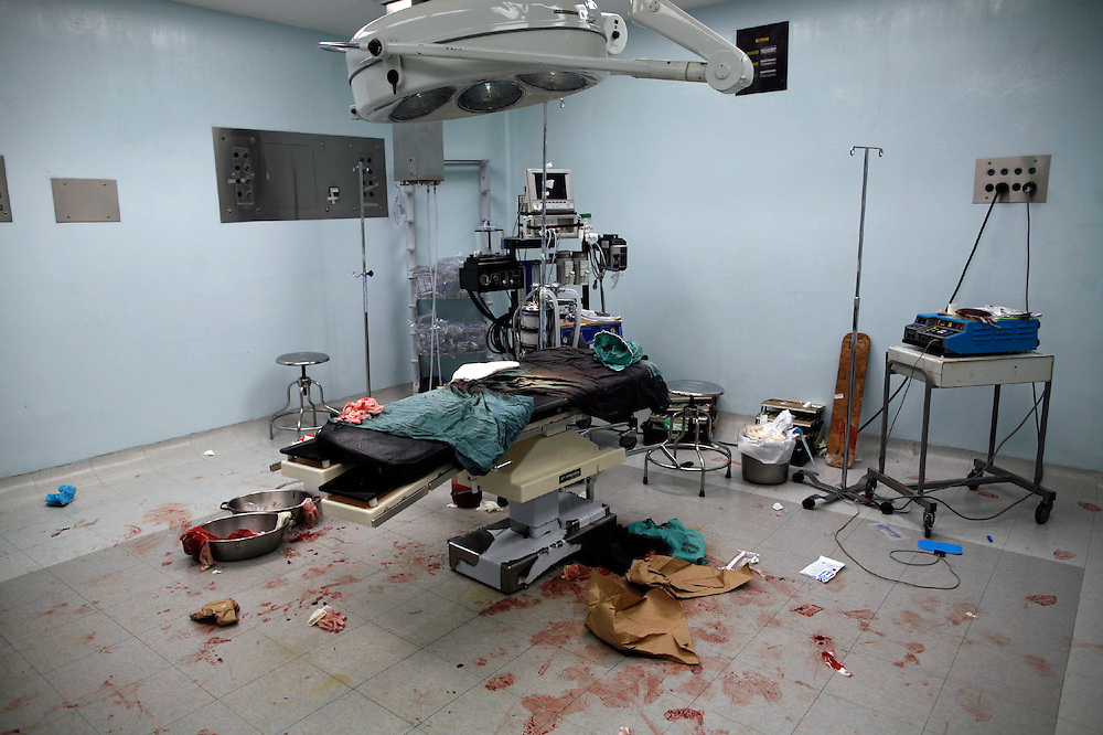 An operation room is seen after surgeons and medicine residents  operate a man  who arrive with firearm injuries at the emergency room of the San Juan de Dios hospital, Guatemala City, Wednesday, May  5, 2010. (AP Photo/Rodrigo Abd)