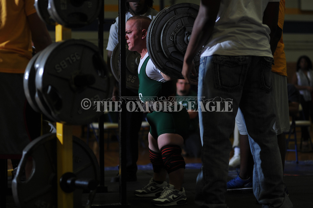 A Lake Cormorant weightlifter squats during Class 5A Region weightlifting competition at Oxford High School in Oxford, Miss. on Saturday, February 9, 2013.