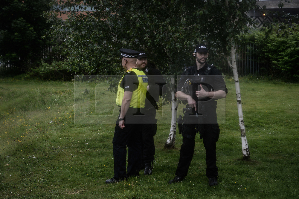 © Licensed to London News Pictures. 05/06/2017. Newcastle Upon Tyne, UK.  Armed police stand guard as Jeremy Corbyn MP, Leader of the Labour Party, addresses a crowd of hundreds of his supporters who waited in the rain to hear him speak outside the Sage in Gateshead. Mr Corbyn spent one of the final days of the campaign trail in the Labour heartlands of North-East England before voters go to the polls in the UK General Election on June 8th 2017. Photo credit: MARY TURNER/LNP