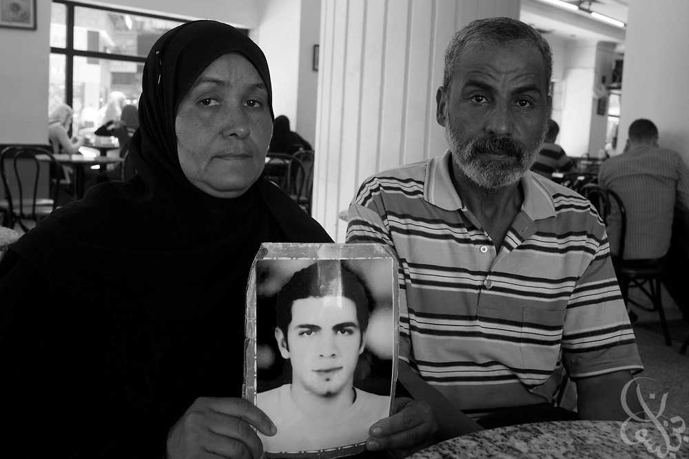 Mona Gabr Taufiq (l) age 48, and her husband Mustafa Mohammed Mursi, age 60, hold a photo of their son Mohammed Mustafa Mohammed Mursi in downtown Cairo, Egypt July 30, 2011. Mohammed was killed by police in the El Marg area of Cairo during the revolution in Jan 2011 and now they are trying to ensure his case is brought before the courts so that the police officers accused of killing Mohammed are brought to justice. . (Photo by Scott Nelson for Stern)