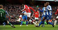 Emmanuel Adebayor Scores 1st goal as Titus Bramble Wigan Athletic challenges<br /> Arsenal 2008/09<br /> Arsenal V Wigan Athletic 06/12/08<br /> The Premier League<br /> Photo Robin Parker Fotosports International
