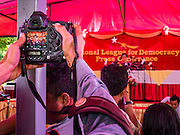 "05 NOVEMBER 2015 - YANGON, MYANMAR: A journalist photographs AUNG SAN SUU KYI during a press conference Thursday. During the press conference, which lasted 90 minutes, Aung San Suu Kyi, the leader of the National League for Democracy (NLD), said that if the NLD won the election she would serve ""above"" the President. When questioned about the Rohingya crisis in western Myanmar, a reporter called the situation ""dramatic"" and Suu Kyi replied the entire country is in a ""dramatic situation"" and the problems of the Rohingya should not be ""exaggerated."" She said the ""great majority of our people remain as poor as ever."" She also said the NLD would make a ""fuss"" if election results were ""suspicious."" Citizens of Myanmar go to the polls Sunday November 8 in what is widely viewed as the most democratic and contested election in Myanmar's history. The NLD is widely expected to win the election.   PHOTO BY JACK KURTZ"