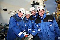 Oasis of the Seas. Float Out, Turku, Finland..Royal Caribbean's Oasis of the Seas the worlds largest cruise ship, enters final construction phase  at STX ship yard in Finland..Wheel turning to flood the dry dock..L-R Richard Fain (Chairman and CEO Royal Caribbean) Harri Kulovaara (Senior VP Marine Royal Caribbean) Martin Landtman (President, STX Finland Cruise) Toivo Ilvonen (Project Director Oasis Class)