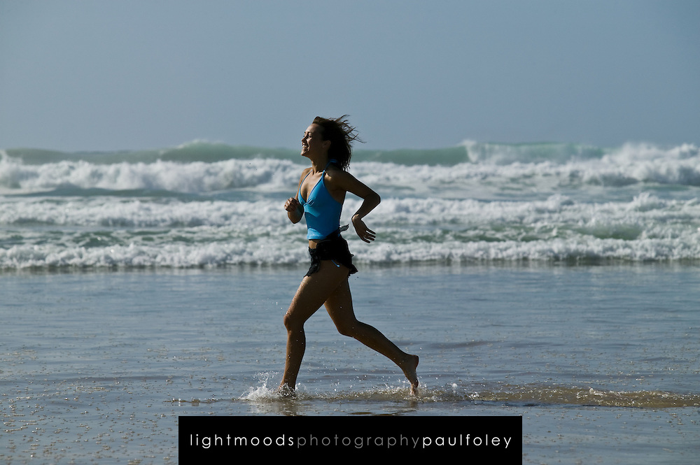 Woman running on beach. Samurai Beach, Port Stephens, East Coast Australia